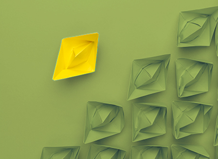 yellow-paper-ship-out-of-the-crowd-concept