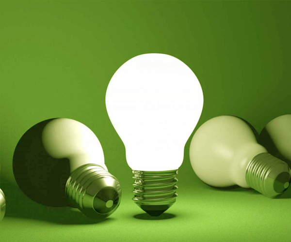 a-bright-light-bulb-on-a-green-background