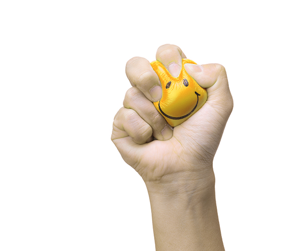 hand-squeezing-smile-face-stress-ball